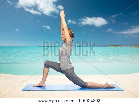 happy woman making yoga in low lunge on mat