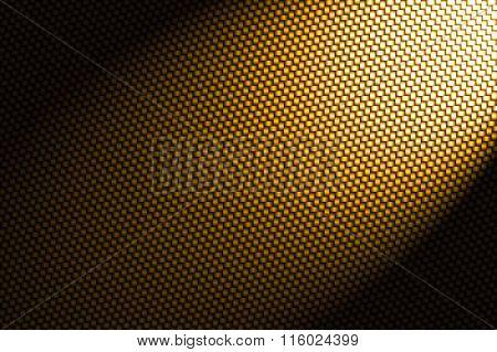 Spotlight On Yellow Carbon Fiber Background.