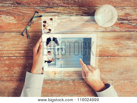 close up of hands with tablet pc and web page