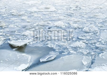 Ice Fragments Covered With Show On Cold River