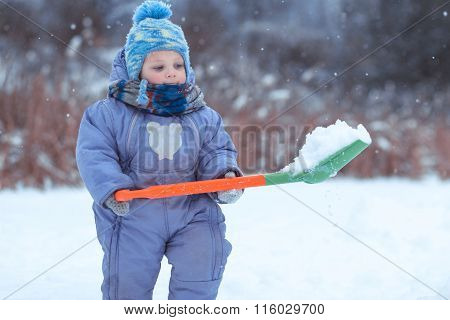 The Small Child The Boy Plays With A Shovel