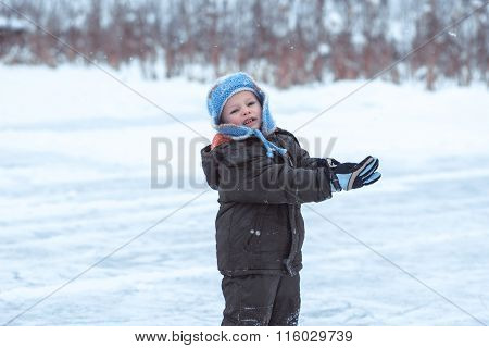 The Little Boy On A Winter Skating Rink Wriggles