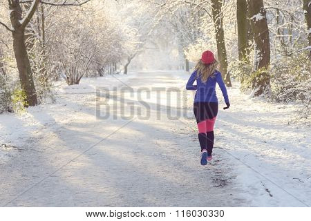 Young Woman Jogging In Winter