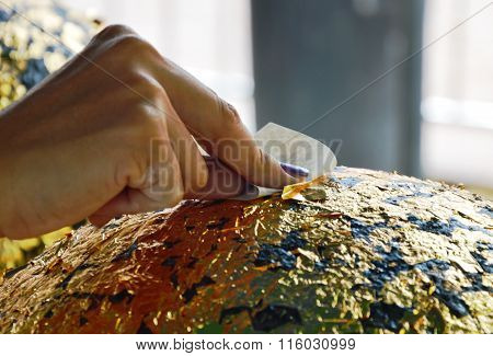 Buddhism put gold leaf on round stone