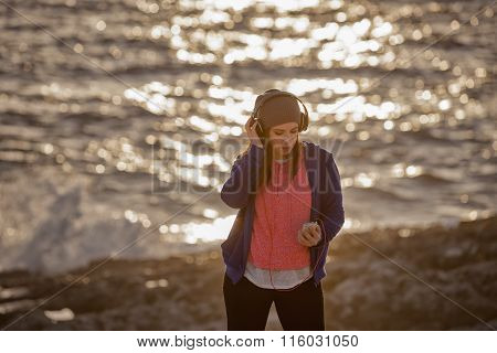 Girl With Headphones At The Beach