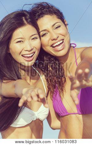 Instagram filter style photo of beautiful young women girls in bikinis laughing having fun on a beach