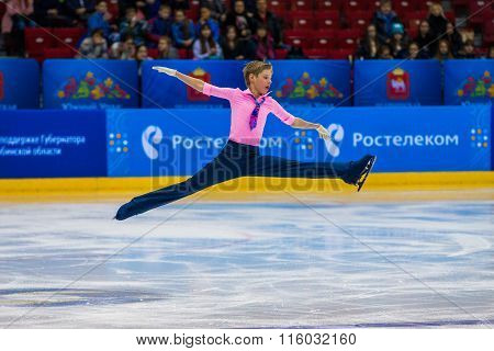 young athlete skater male performance in short program on ice