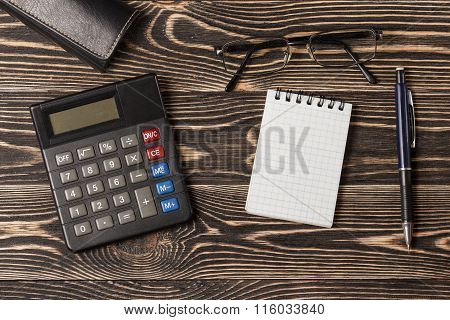 Pen, notebook and calculator