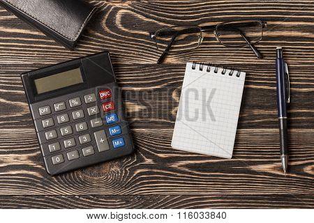 Pen, notebook and calculator