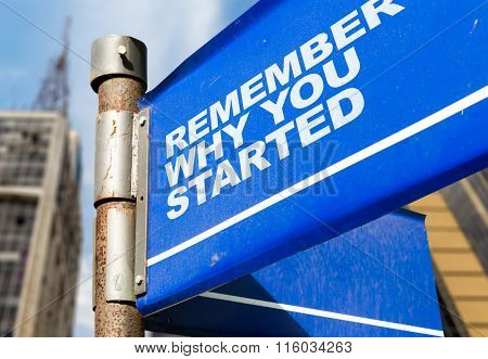 Remember Why You Started written on road sign