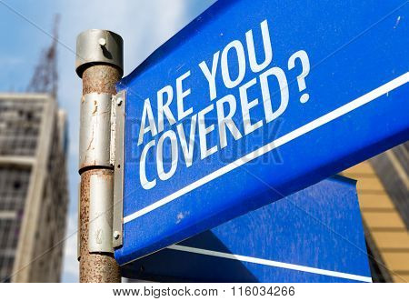 Are You Covered? written on road sign