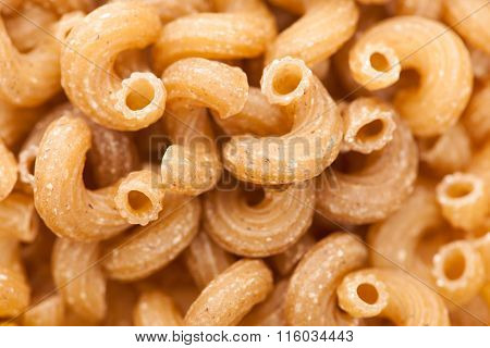 Texture Background Of Raw Italian Pasta Fusilli Macaroni Made Of Spelt Flour.