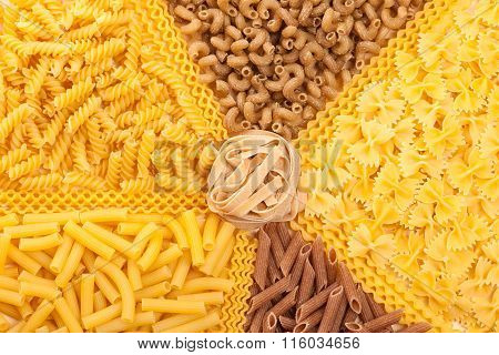 Assortment Of Italian Pasta, Five Different Varieties Separated With Curly Spaghetti And Bunch Of No