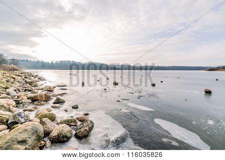Frozen Lake With Rocks
