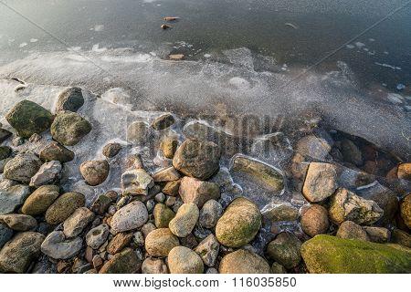 Rocks At A Frozen Lake