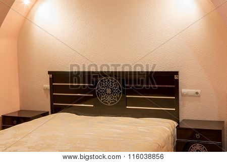 Bedside Table Near The Bed