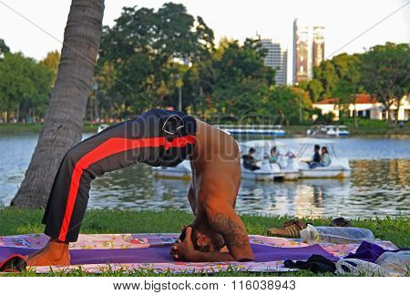 man is excersing outdoor in park of Bangkok