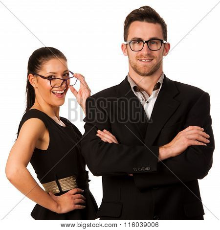 Confident Business Couple Standing Next To Each Other. Woman Looking Over The Glasses And Smiling. C