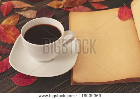 Cup Of Coffee With A Book And Red Autumn Leaves