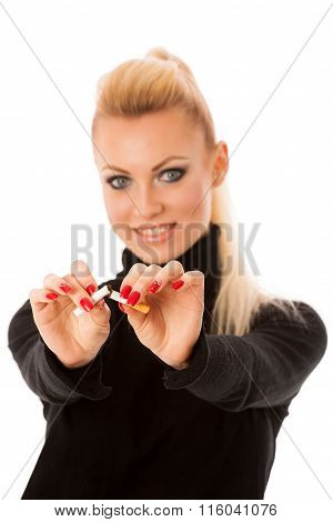 Happy Woman Gesturing Quitting Stinky Unhealhy Habbit By Breaking Cigarette Decided To Quit Smoking.