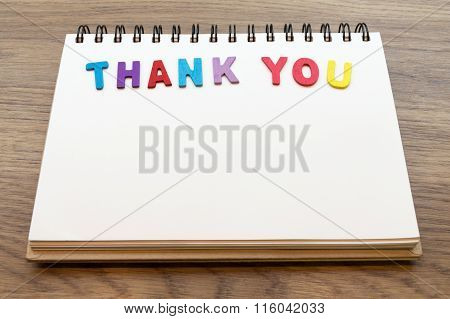 Wood Colorful Letter Word Thank You Lay Down Notebook On Wood Background