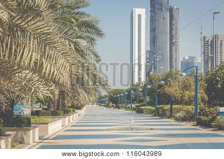 Park On The Seafront Against The Backdrop Of Abu Dhabi Buildings