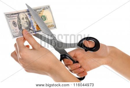 Hands with scissors cutting dollar banknote, isolated on white