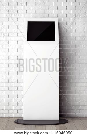 White Information Stand In Front Of Brick Wall With Blank Frame