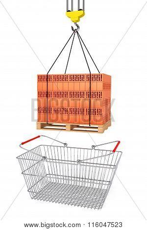 Red Bricks Over Wooden Pallet With Supermarket Shopping Basket