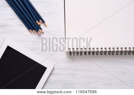 Blank Sketchbook With Color Pencils And Tablet Gadget