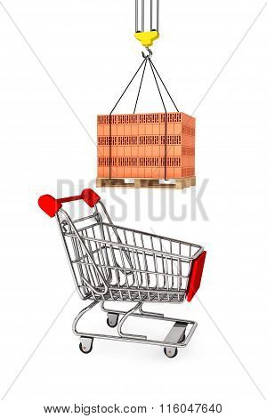 Red Bricks Over Wooden Pallet With Supermarket Shopping Cart