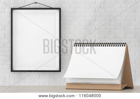 Blank Paper Desk Spiral Calendar In Front Of Brick Wall With Blank Frame