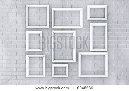White Picture Frames On A Brick Wall