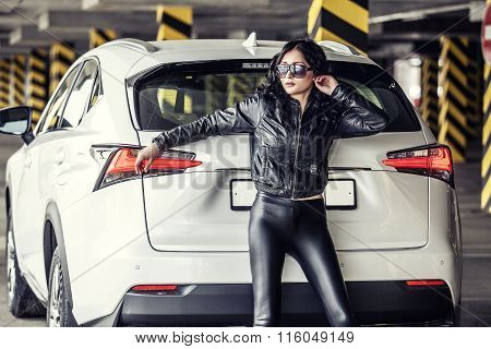 Beautiful Sexy Female Model With A White Car In The Parking Lot
