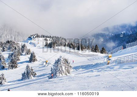 Vibrant panorama of the slope at ski resort Kopaonik, Serbia, snow trees, fog