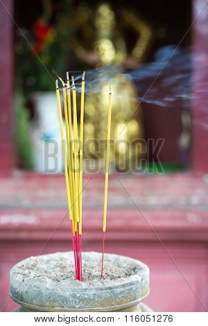 Burning Joss Sticks In Pagoda, Saigon, Vietnam