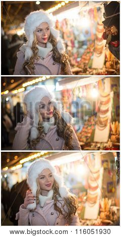 Young woman with white fur cap admiring accessories in Xmas market, cold winter evening