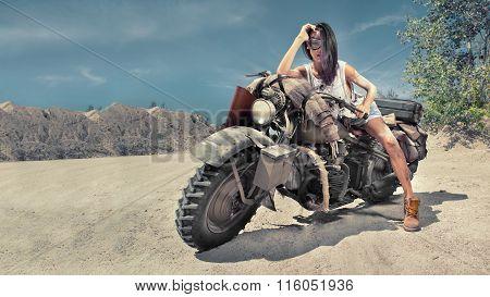 Sexy Biker Woman On The Desert Background.
