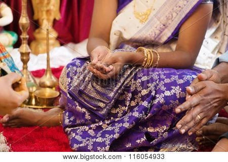 Woman received prayers from priest. Traditional Indian Hindus religious ceremony. India special rituals events.