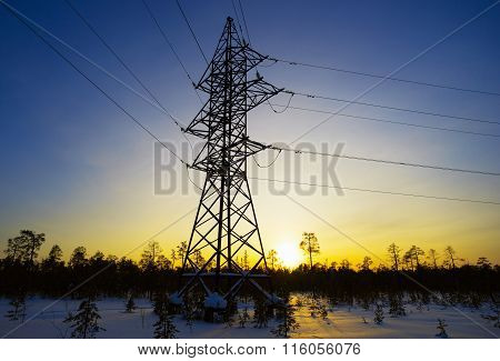Line Of Electricity Transmission In  Winter At Sunset.
