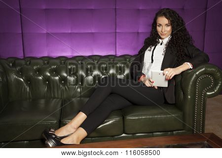 Portrait of a beauty young adult attractive sensuality and sexy pretty brunette businesswoman working on tablet on luxury retro vintage style sofa at home
