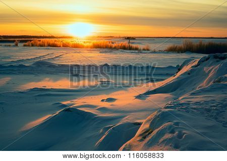 Bright Sun  Sunset In Winter With Large Snow Drifts.