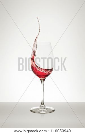 red wine splashing out of the glass