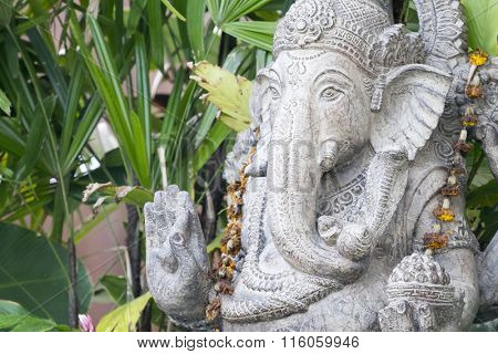An image of a ganesha sculpture in the garden