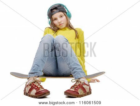 Pretty Young Girl Posing With A Skateboard, Sitting On Skate, Listen A Music