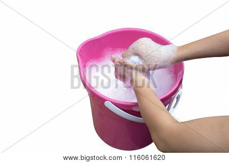 Hand Washing Clothes In The Basin.