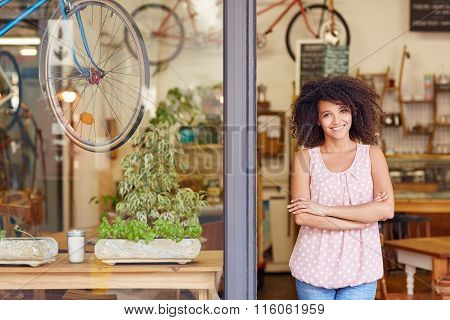 Coffee shop owner standing in the door of her cafe