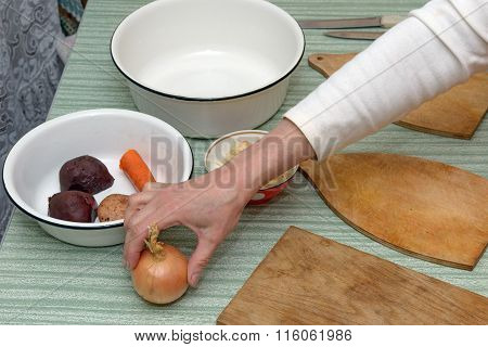 Kitchen Table With Hand Of Woman That Putting The Bulb.