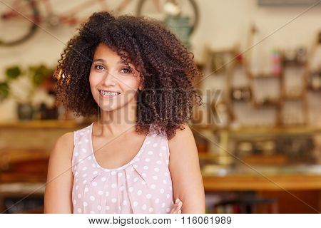 Beautiful mixed race woman smiling in a coffee shop