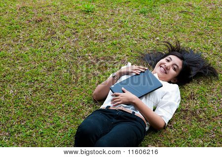 female student relaxing in the park